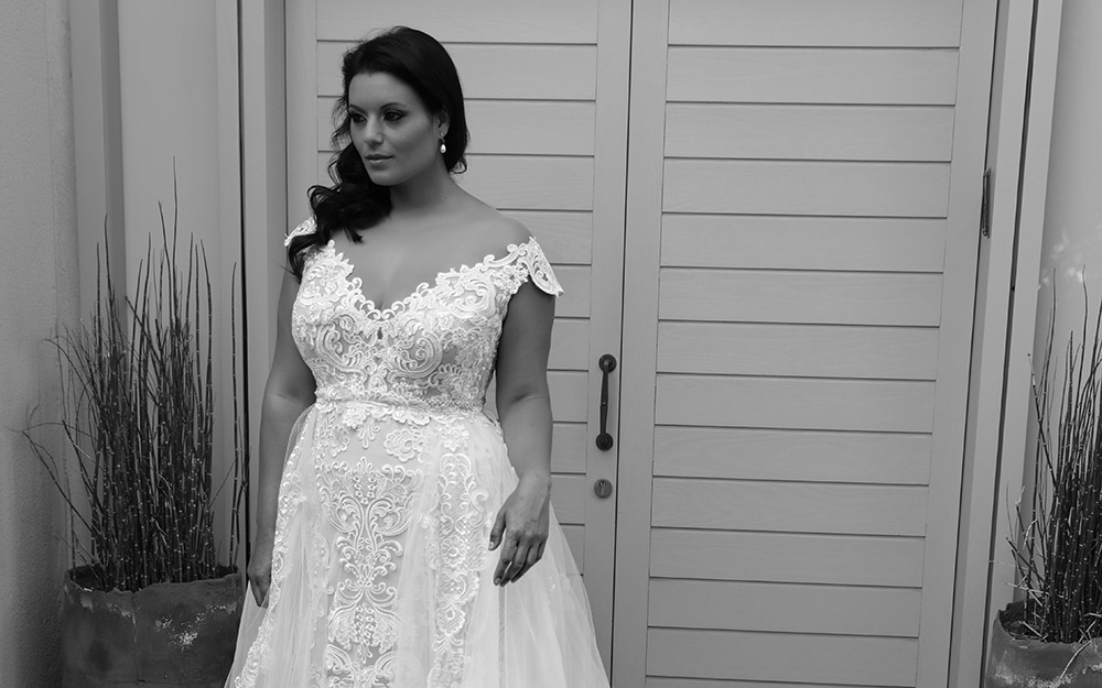 Adel by studio levana plus size fitted all lace bridel gown with an open nackline and a tulle over top skirt