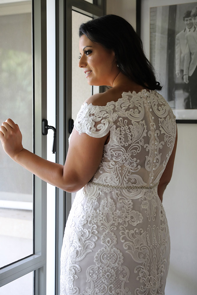 Adel by studio levana plus size fitted all lace bridel gown with an open nackline