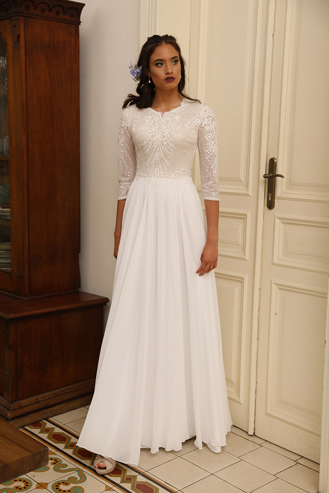 Adelaid by studio levana modest bridel gown with sparkls and sequined lace top and flowy skirt