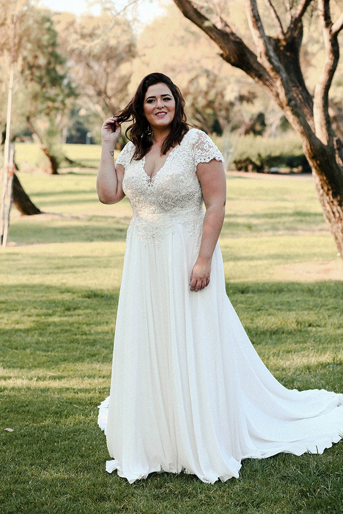 Alison by studio levana classic plus size bridel gown with baeded lace top short sleeves and a long lace train