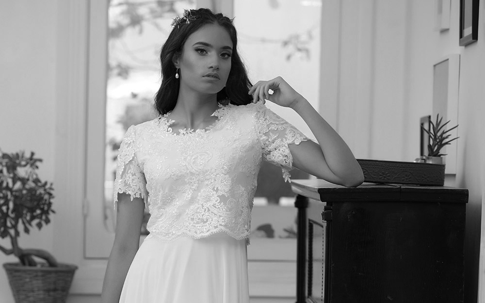 Aria by studio levana modest short sleeves wedding dress with baeded lace and flowy skirt