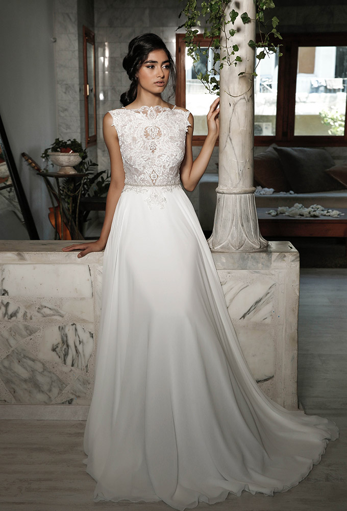 dara by studio levana beaded lace modern wedding dress with a clean skirt and rich top