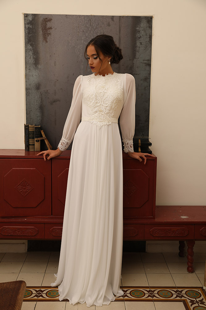 Faina by studio levana classic modest bridel gown with baeded lace top and sheer long sleeves