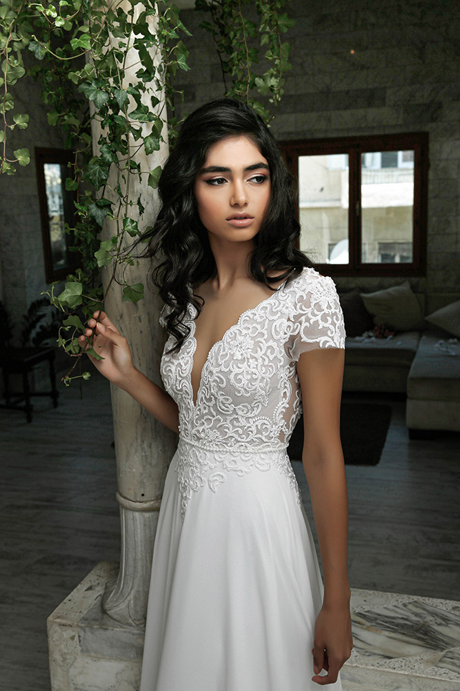 Hadar by studio levana deep v nackline with baeded lace wedding dress short sleeves and flowy classic skirt