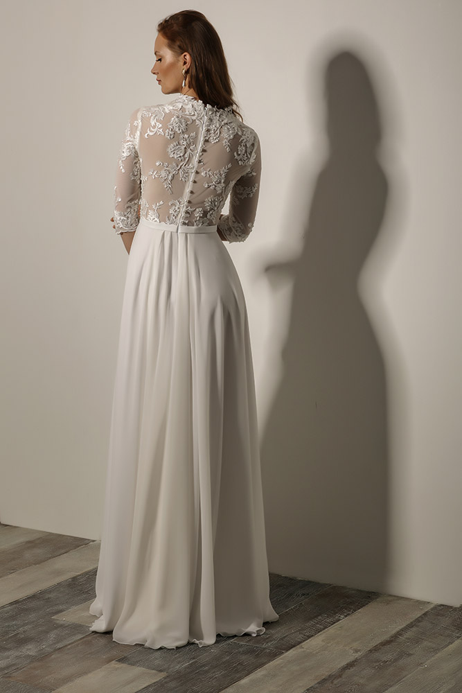 Kalina by studio levana modest and romantic wedding dress with floral lace and a flowy skirt