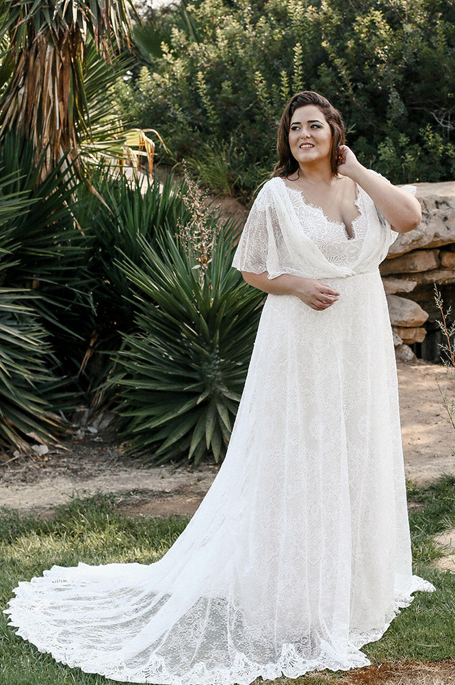 kelly by studio levana a line seqined lace wedding dress with short flowy sleeves and a sculpet lace nackline