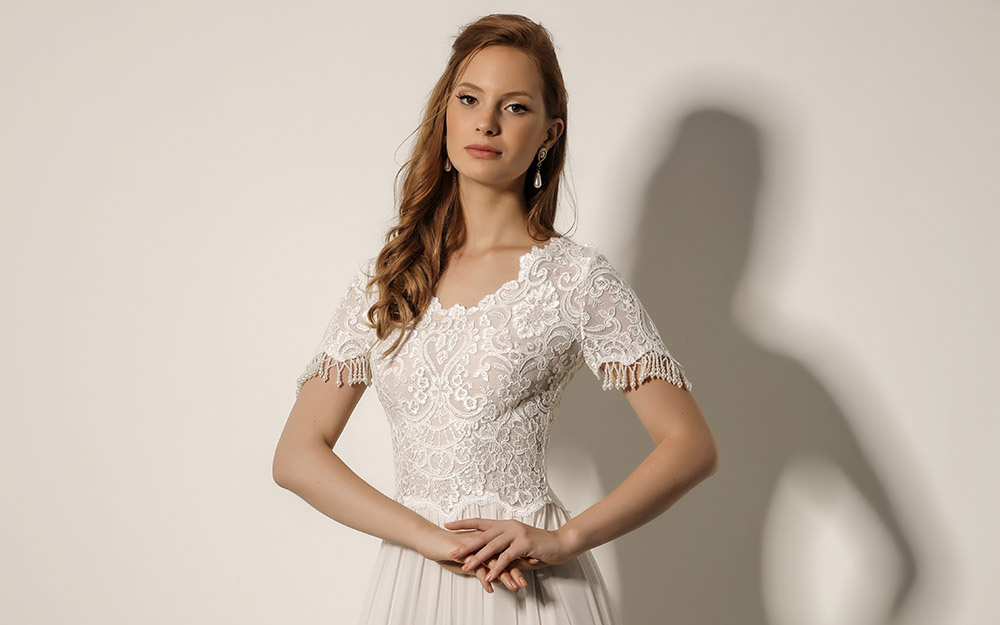 Keren by studio levana boho chic bridel gown with lace top and short sleeves