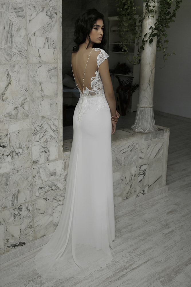 Lana by studio levana beutifull scuplted lace wedding dress with fitted skirt and illusion back