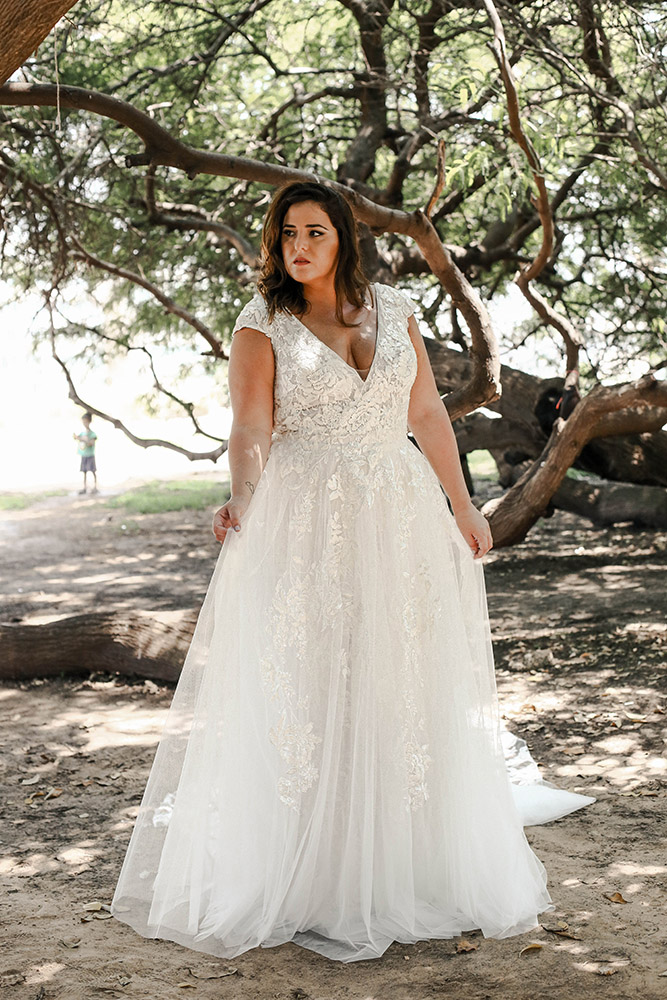 Lana by stodio levana. plus size wedding dress v nack and cup sleeves with tulle and lace and long train over skirt