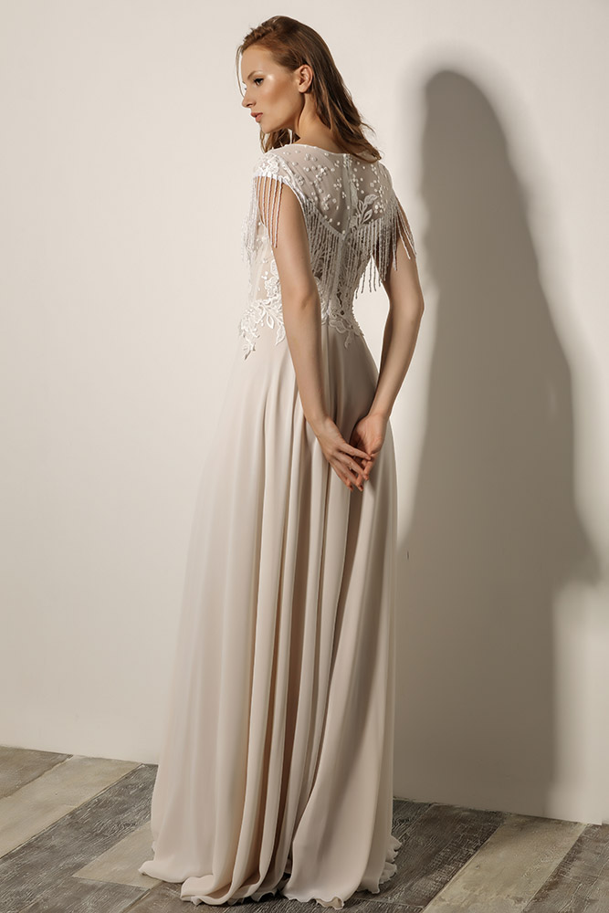 Lera by studio levana modest wedding dress boho style with fringe sleeves and sparkly lace