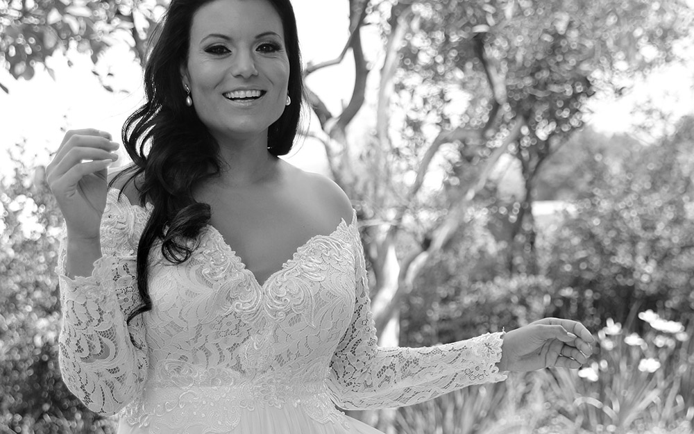 Lida by studio levana plus size all lace wedding dress with a big open nackline long sleeves