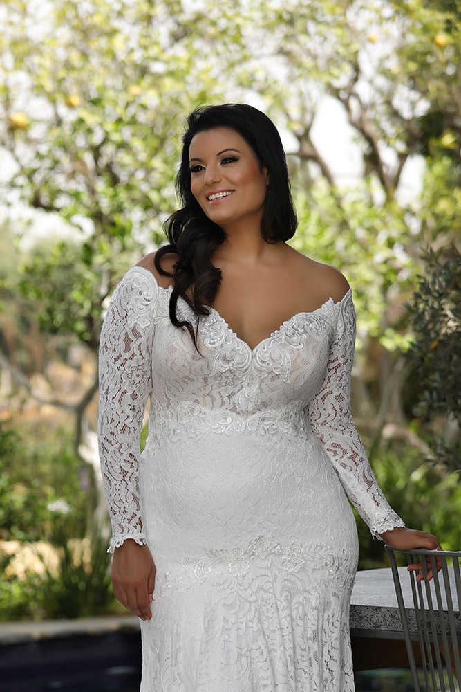 Lida by studio levana plus size all lace wedding dress with a big open nackline long sleeves and a marmaid skirt