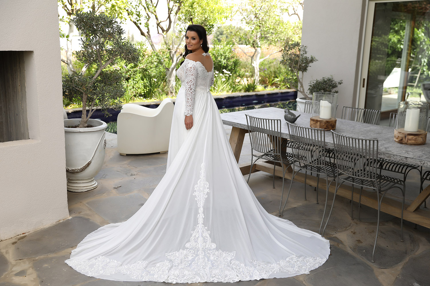 Lida by studio levana plus size all lace wedding dress with a big open nackline and over top shiffon train skirt