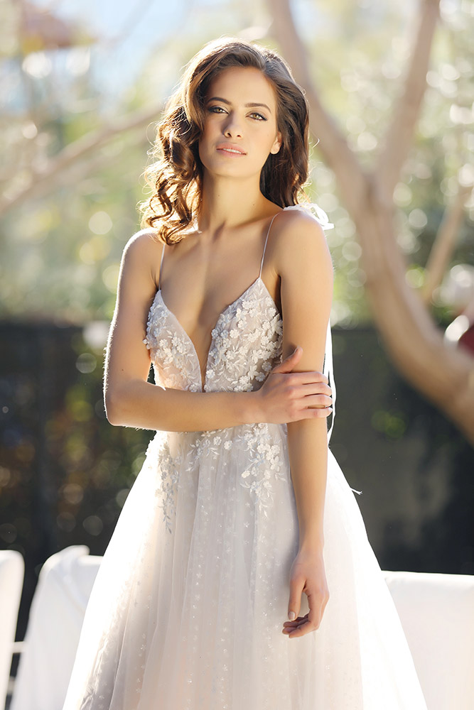 Linoi by studio levana spagethi starps ball gown wedding dress with gental floral lace and a sparkly tulle princess skirt