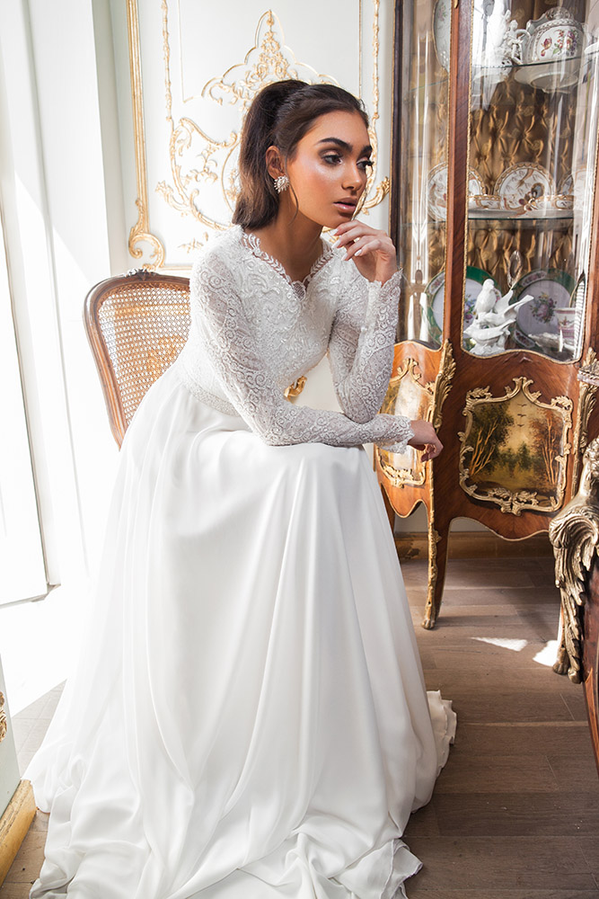 Lior by studio levana modest wedding dress v nackline with long lace sleeves and a flowy shiffon skirt