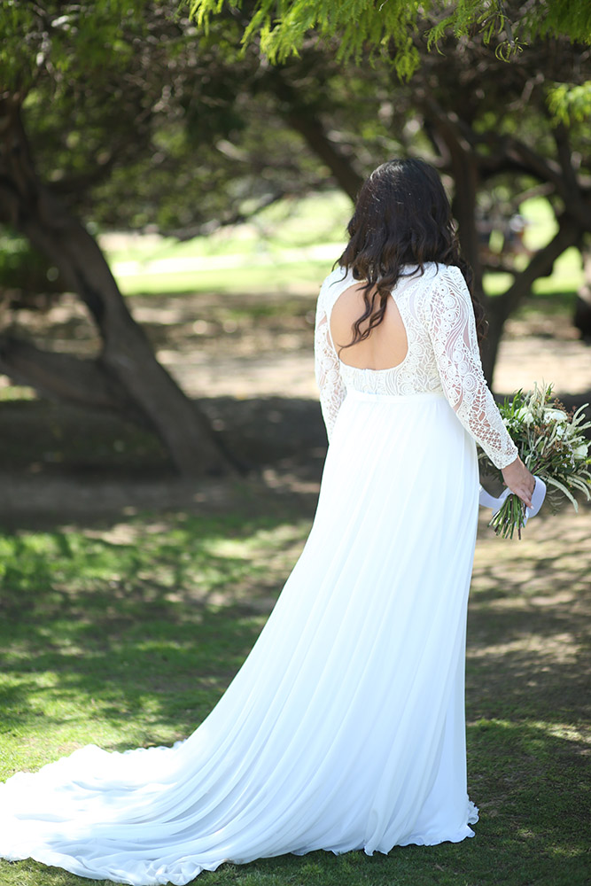 Margo by stodio levana plus size boho style wedding dress with long geometric lace sleeves amd a clean flowy skirt