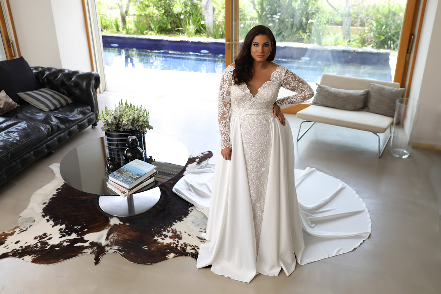 Milena by studio levana plus size fitted all lace wedding dress with long lace sleeves and a over top skirt