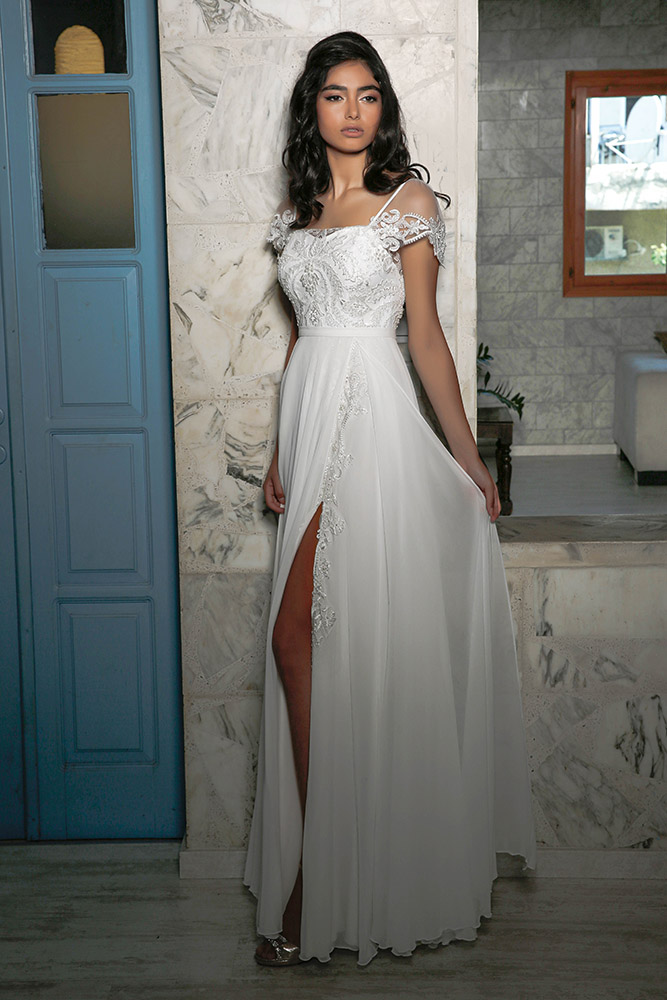 Mira by studio levana lace and baeds couture wedding dress with sort sleeves and a spit skirt