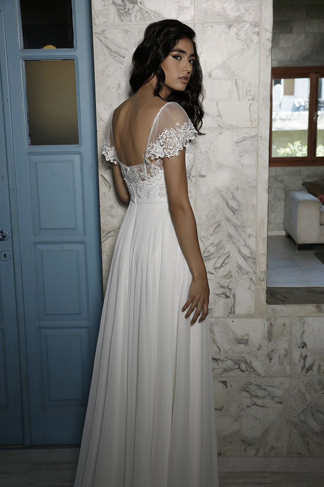 Mira by studio levana lace and baeds couture wedding dress with sort sleeves and open back