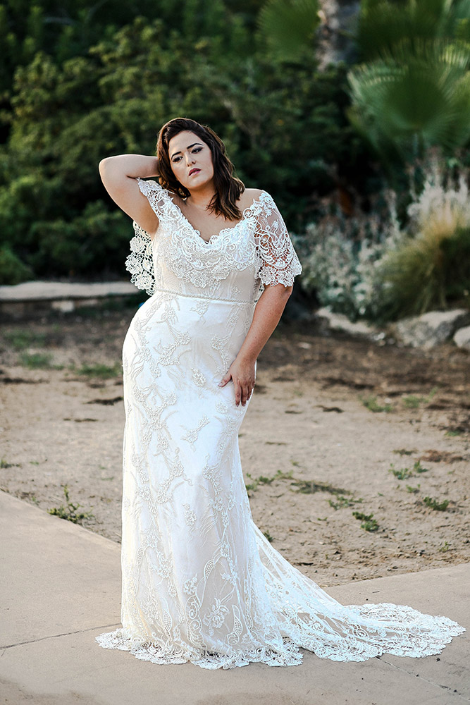 Paisley by studio levana plus size fitted all lace wedding dress with cape sleeves, sculpted long train and beaded belt
