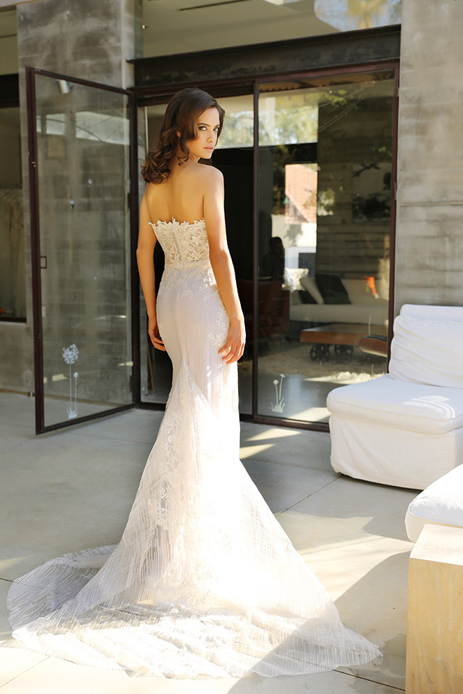 Pazit by studio levana stapless fitted with sheer corset wedding dress with sparkely tulle and floral lace appliques and a long sparkly tule train