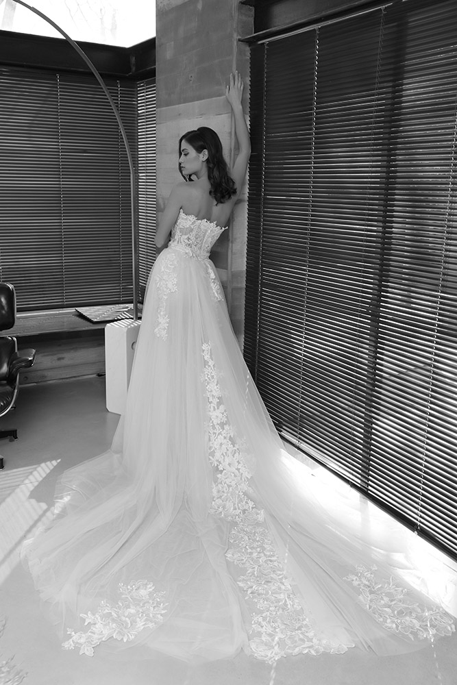 Pazit by studio levana stapless with sheer corset wedding dress with sparkely tulle and floral lace appliques over top tulle ang lace train skirt