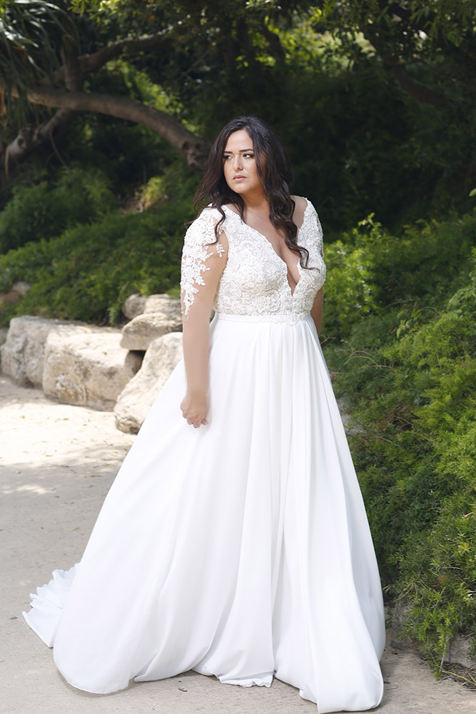 Petra by studio levana plus size wedding dress with baeded lace and a illusion sleeves