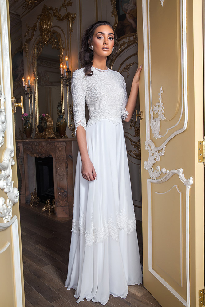 Rika by studio levana boho style modest wedding dress with lace long sleeves top and a lace and shiffon skirt