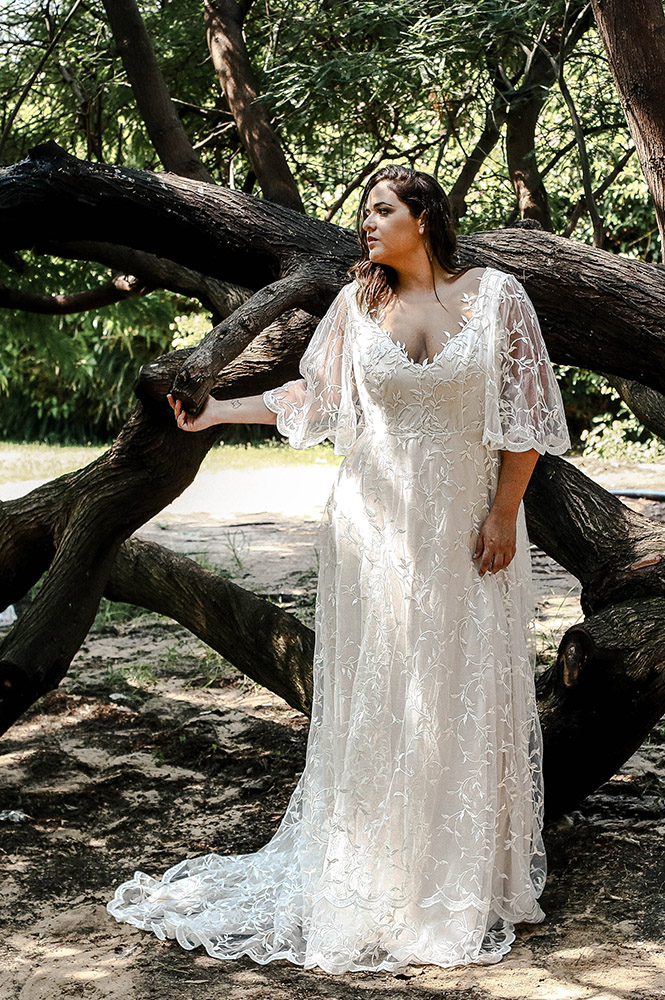 Rosie by studio levana all lace wedding dress withe bell shape sleeves and soft v neckline