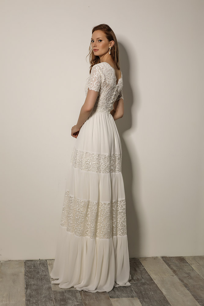 Ruah by studio levana boho chic modest bridel gown with beaded lace top and layerd skirt