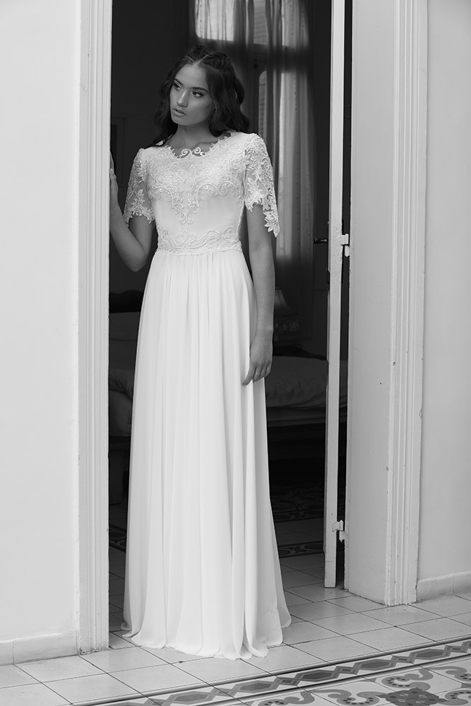 Sannis by studio levana modest wedding gown with short lace sleevs