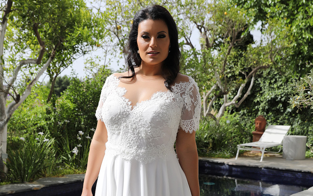 Scarlet by studio levana plus size baeded romantic lace wedding dress with short sleeves and an A line skirt