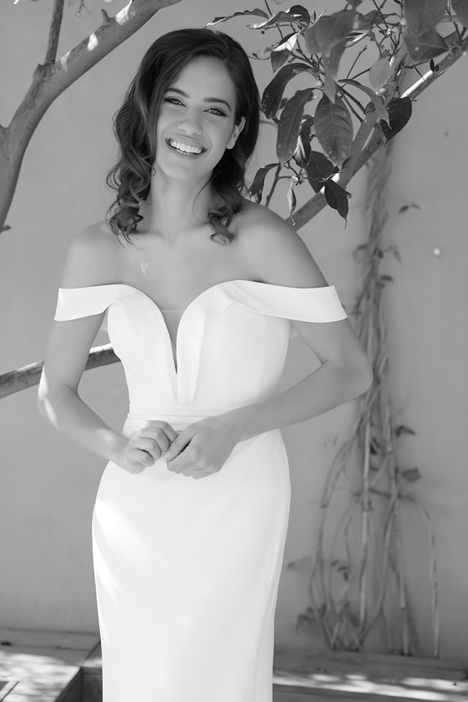 Selah by studio levana classic and clean fittet wedding dress off soulder sterps