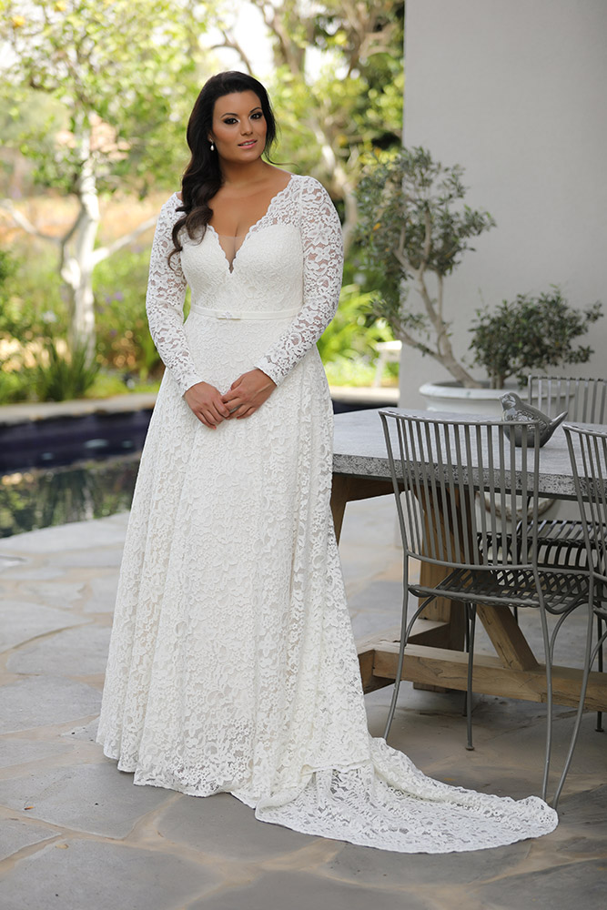 Seline by studio levana plus size all lace wedding dress with an A line skirt and a gental belt and long lace sleeves