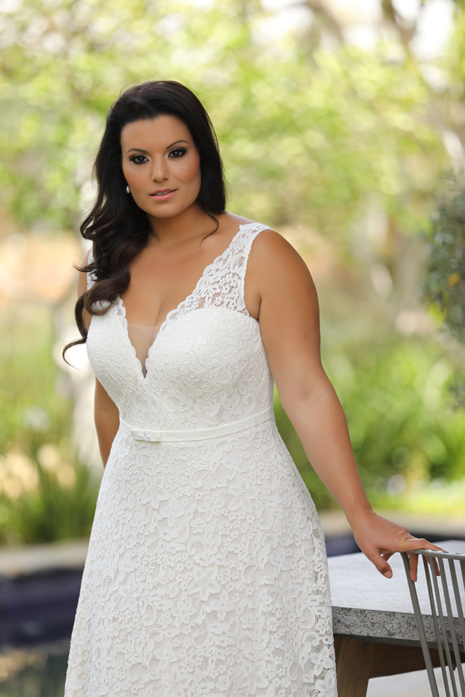 Seline by studio levana plus size all lace wedding dress with an A line skirt and a gental belt