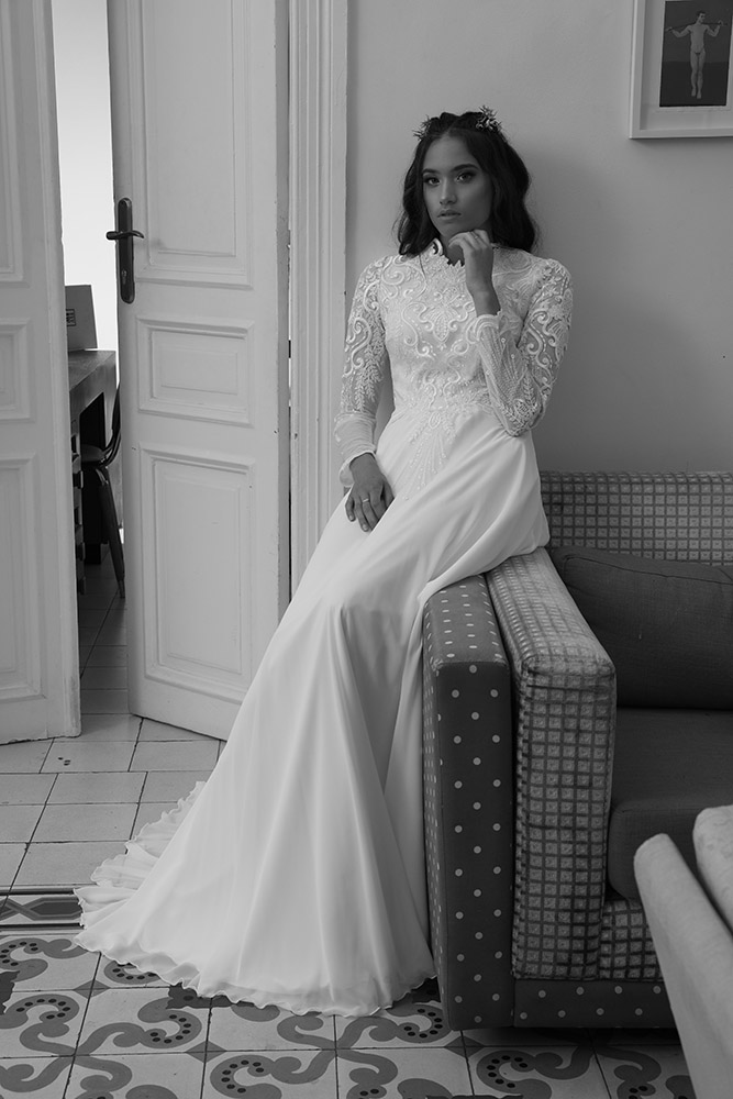 Sian by studio levana modest wedding dress with spakly floral lace and a flowy skirt