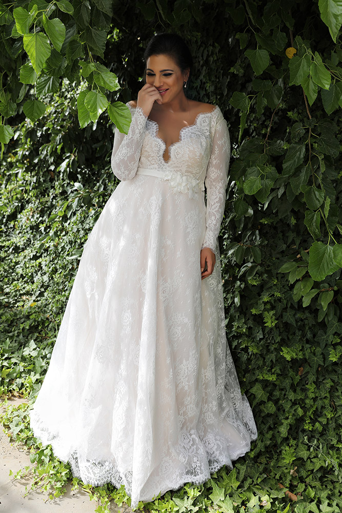 Sophia by studio levana plus size all lace a line weddind dress with a belt and a deep v nackline