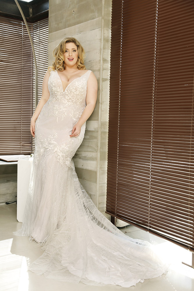 sparkley tulle and lace mermaid plus size wedding dress with sparkley trian