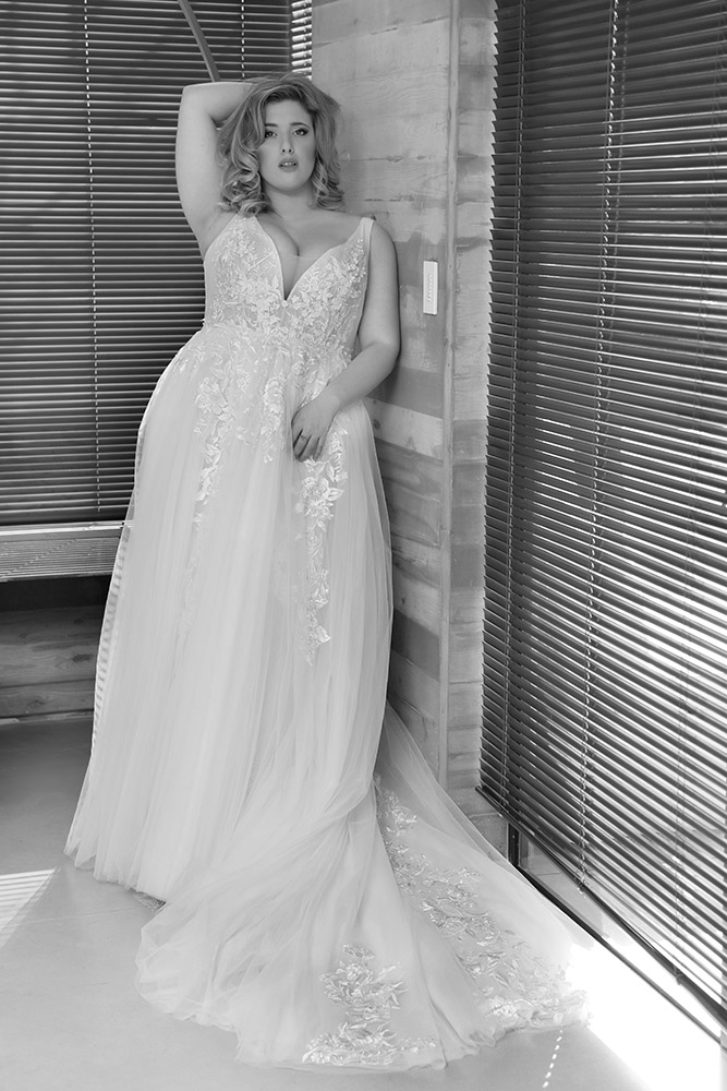 plus size wedding dress with over top tulle and lace skirt with train