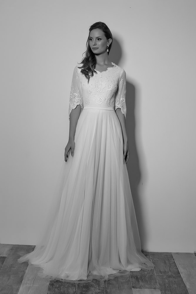 trish by studio levana modst bridel gown with lace baeded top and a tulle a line skirt