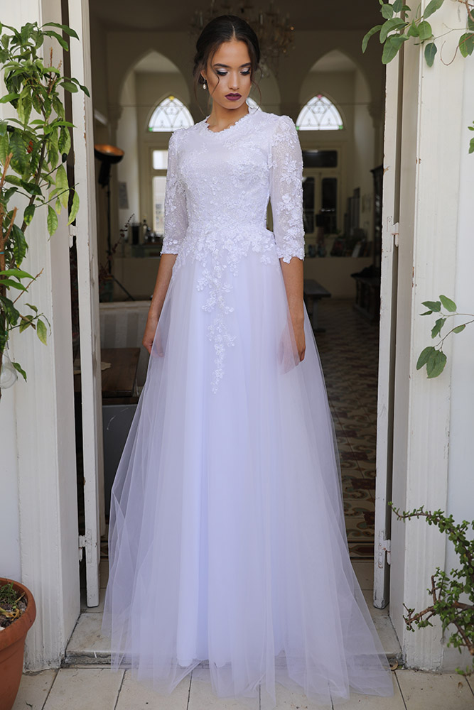 Tulip by studio levana modest ball gown with lace long sleevs and a gentel tulle skirt