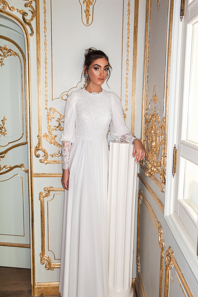 Verona by studio levana modest wedding dress with baeded lace top long sleeves and a clean skirt