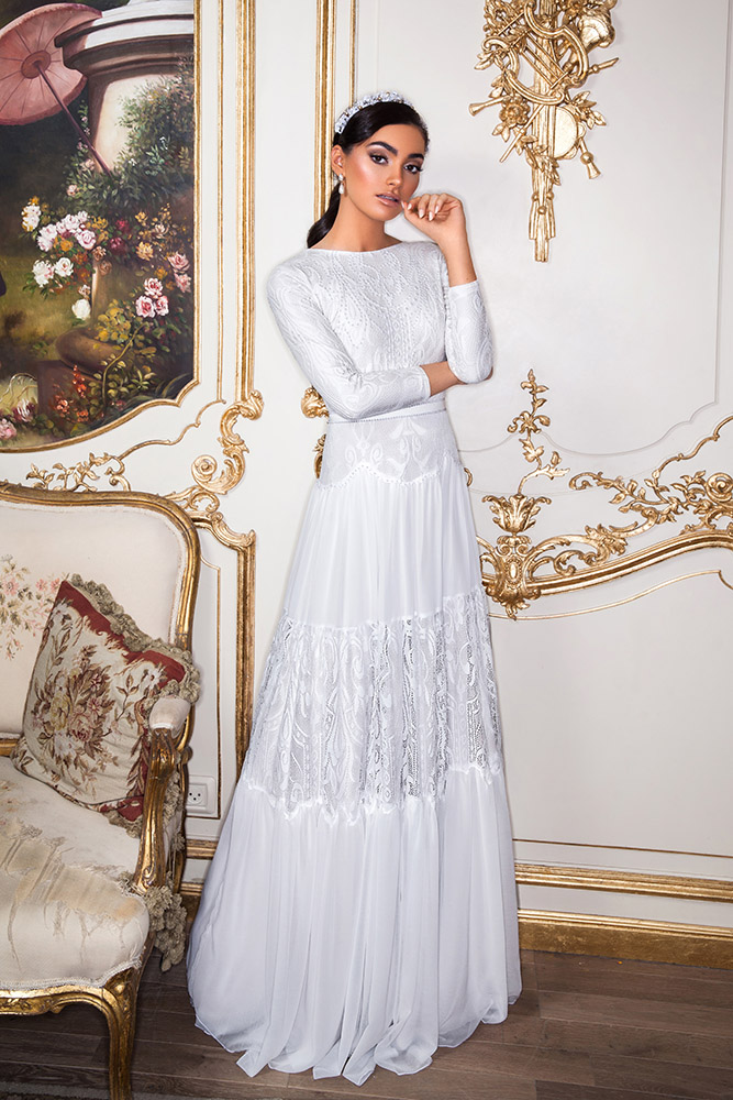 Viena by studio levana modest wedding dress with lace peals and baeds top ang a layerd lace and shiffon skirt