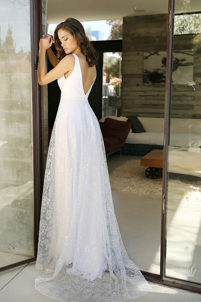Vivienne by studio levana princess wedding dress with sparkly lace skirt and a claedn v nack top